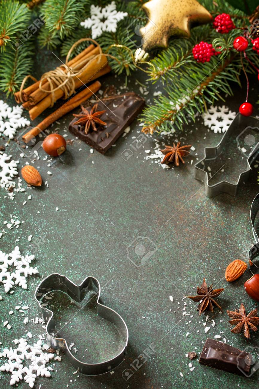 Ingredients for Christmas Gingerbread baking - chocolate, cinnamon, anise and nuts on dark a stone or slate background. Seasonal, food background. Copy space. - 112851433