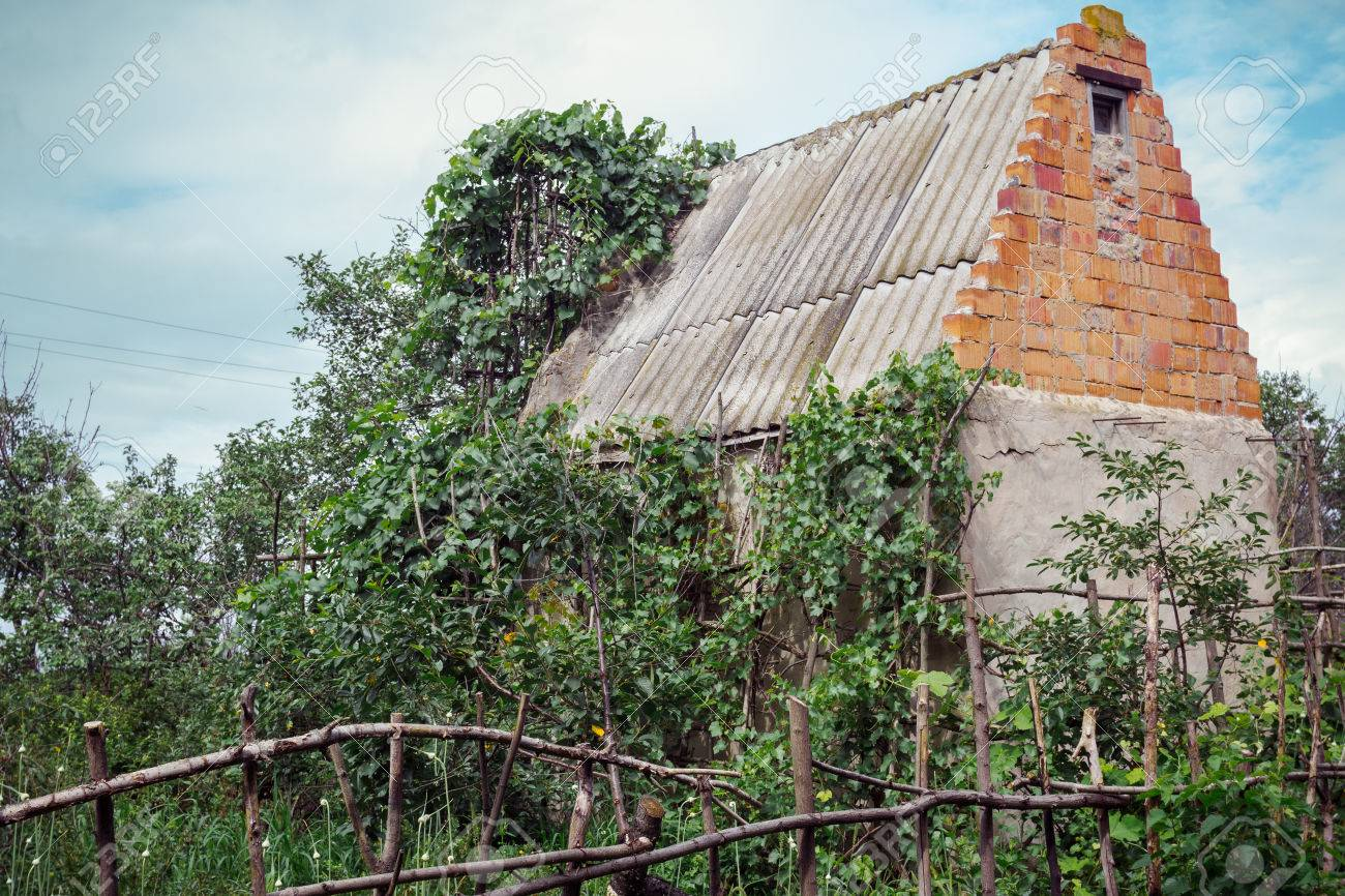 Lovely Abandoned Farm House In Neglected Garden With Wooden Selfmade Hedge Stock  Photo   42017088