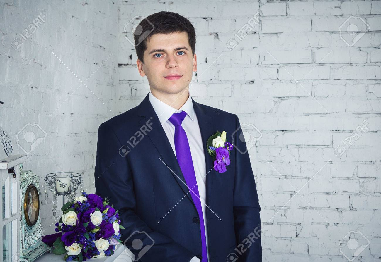 Studio Portrait Of Young Handsome Brunette Groom Wearing Blue ...