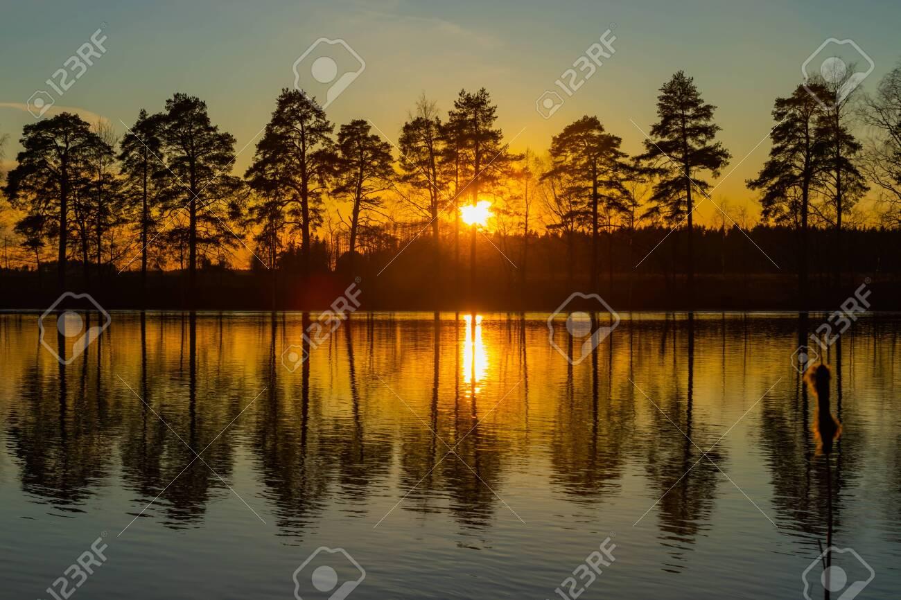 Beautiful sunset on river Kymijoki in February, Finland. - 144748353