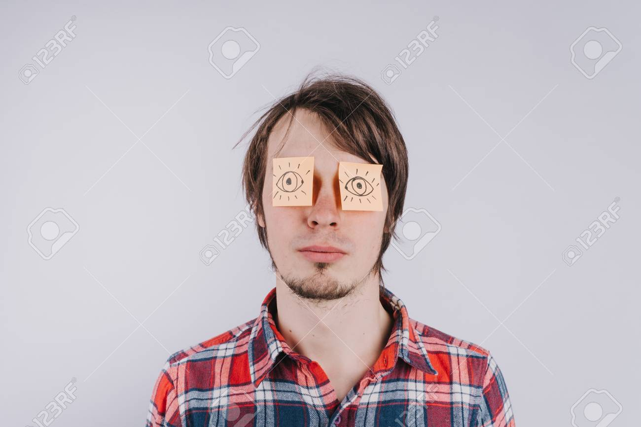 Stickers With Painted Eyes Are Glued On Mans Eyelids Isolated