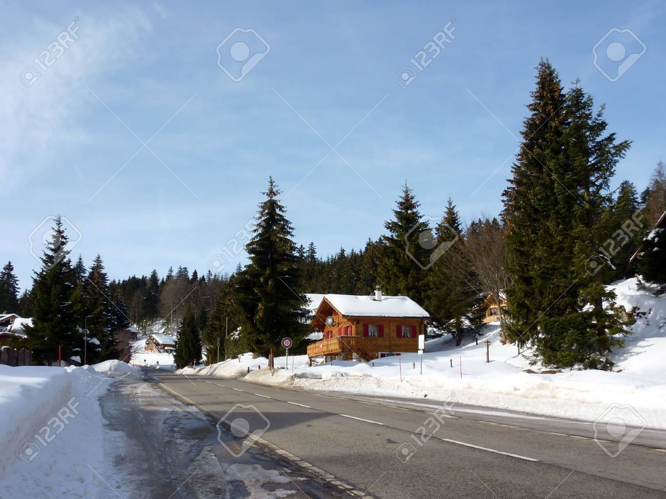Chalet next to the road and surrounded by fir trees by beautiful winter day Stock Photo - 6694808