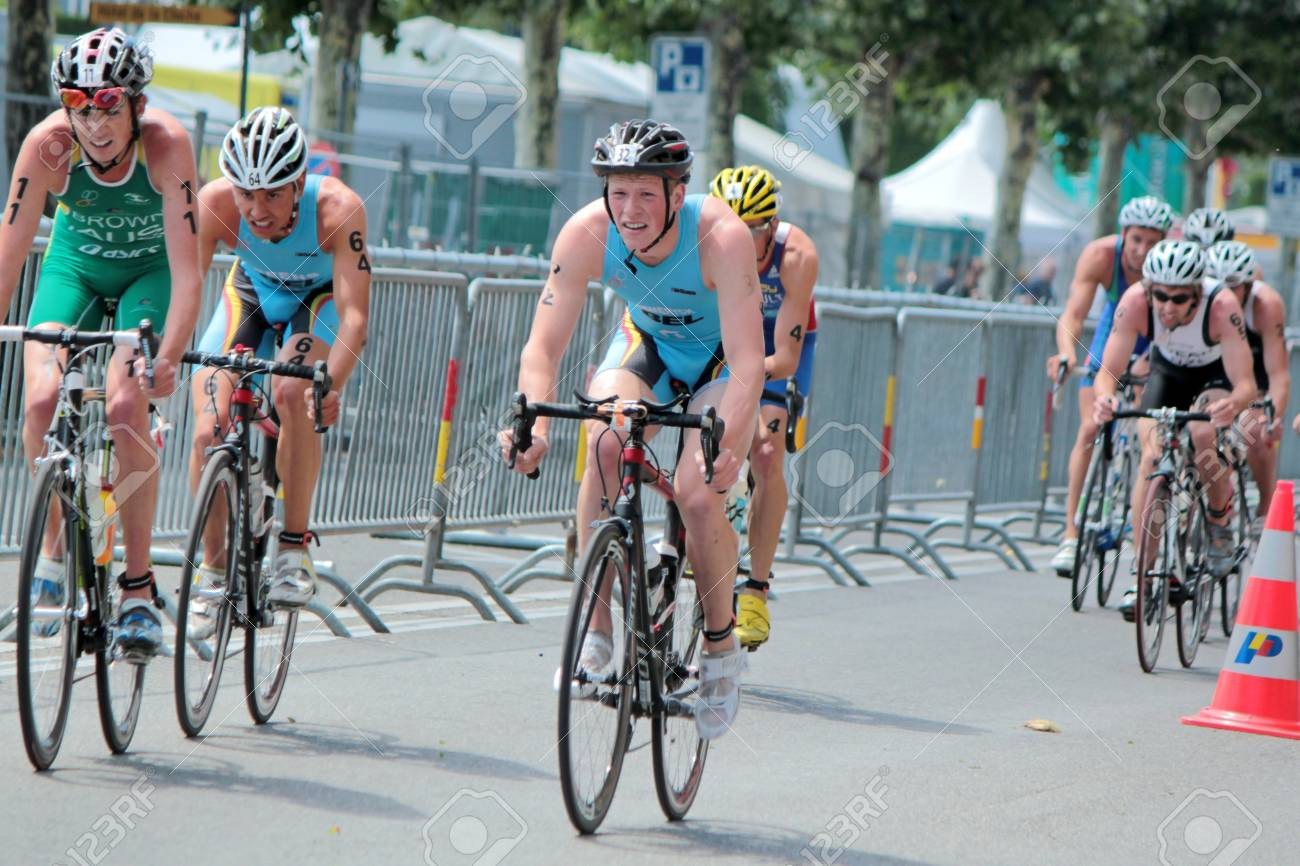GENEVA, SWITZERLAND - JULY 22   unidentified male cyclists at the International Geneva Triathlon, on July 22, 2012 in Geneva, Switzerland  Stock Photo - 14638814