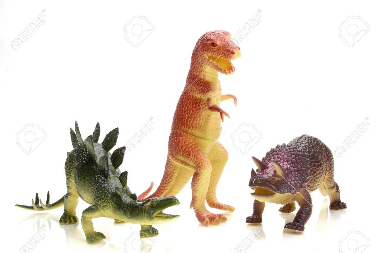 Three toy dinosaurs: Tyrannosaurous Rex, Stegosaurous (L) and Triceritops (R). Stock Photo - 327579