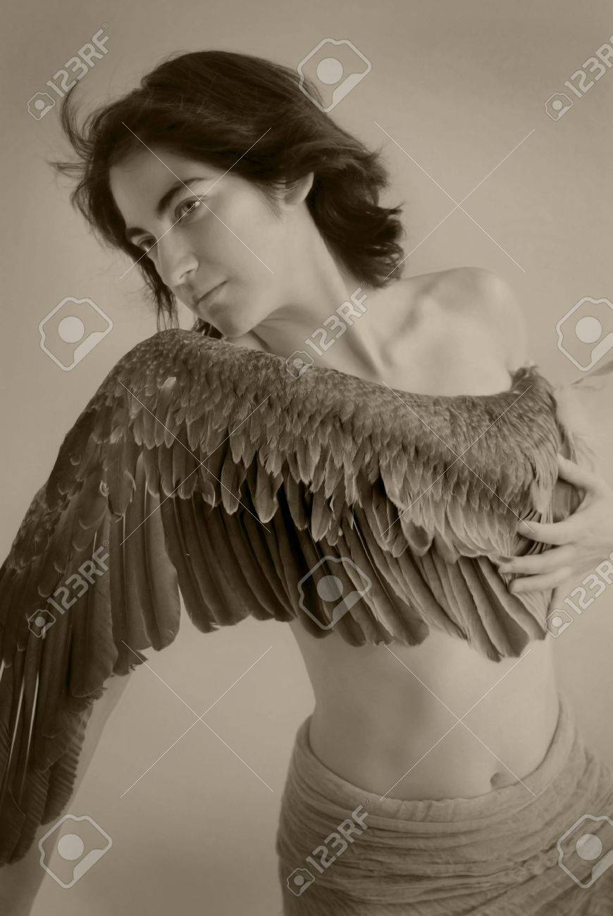 goddess of Victory. Young woman with wing across her breast. Sepia toned black and white photograph. Stock Photo - 2113594