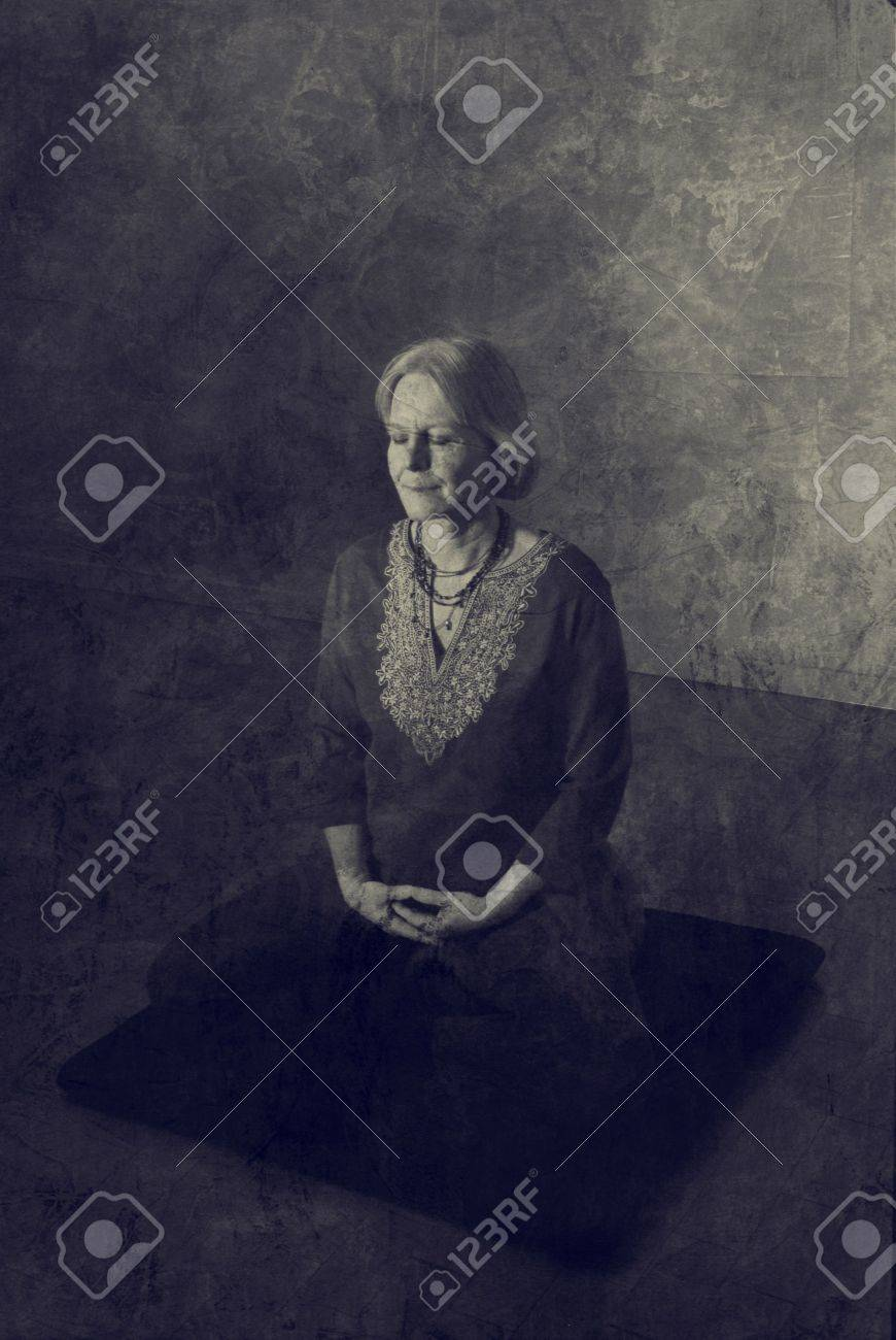 Woman in meditation pose indoors. - 5924841
