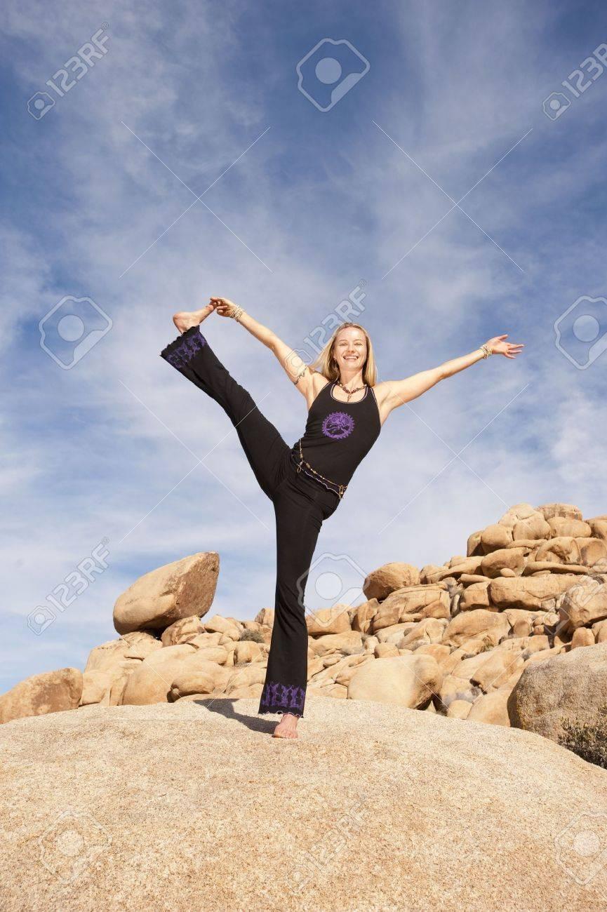 Woman in powerful joyful yoga pose outdoors. Stock Photo - 6862838
