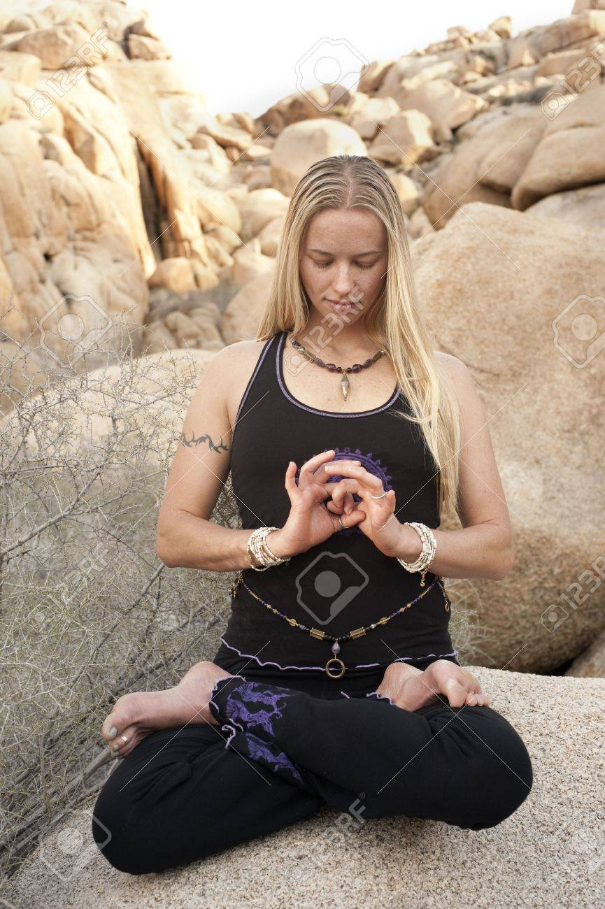 Woman in yoga pose Lotus with hand mudra outdoors. Elise Kost jewelry. Stock Photo - 6862781