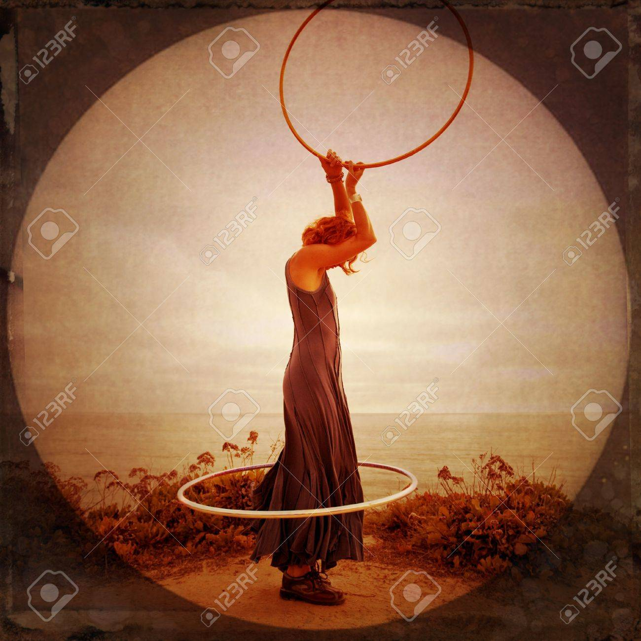 Anonymous woman by the sea with hoops. Photo illustration. - 7351745