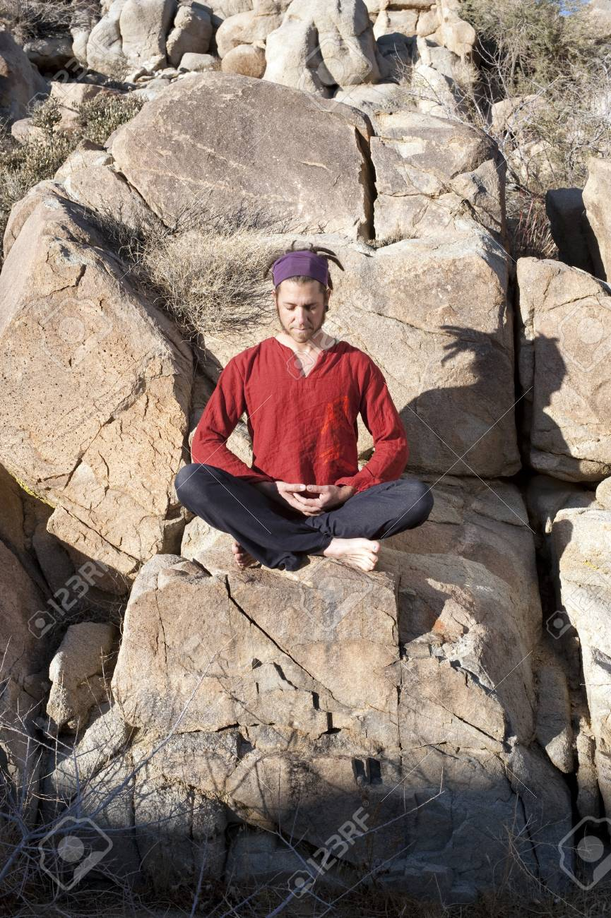 Man in yoga pose outdoors. Stock Photo - 8211901