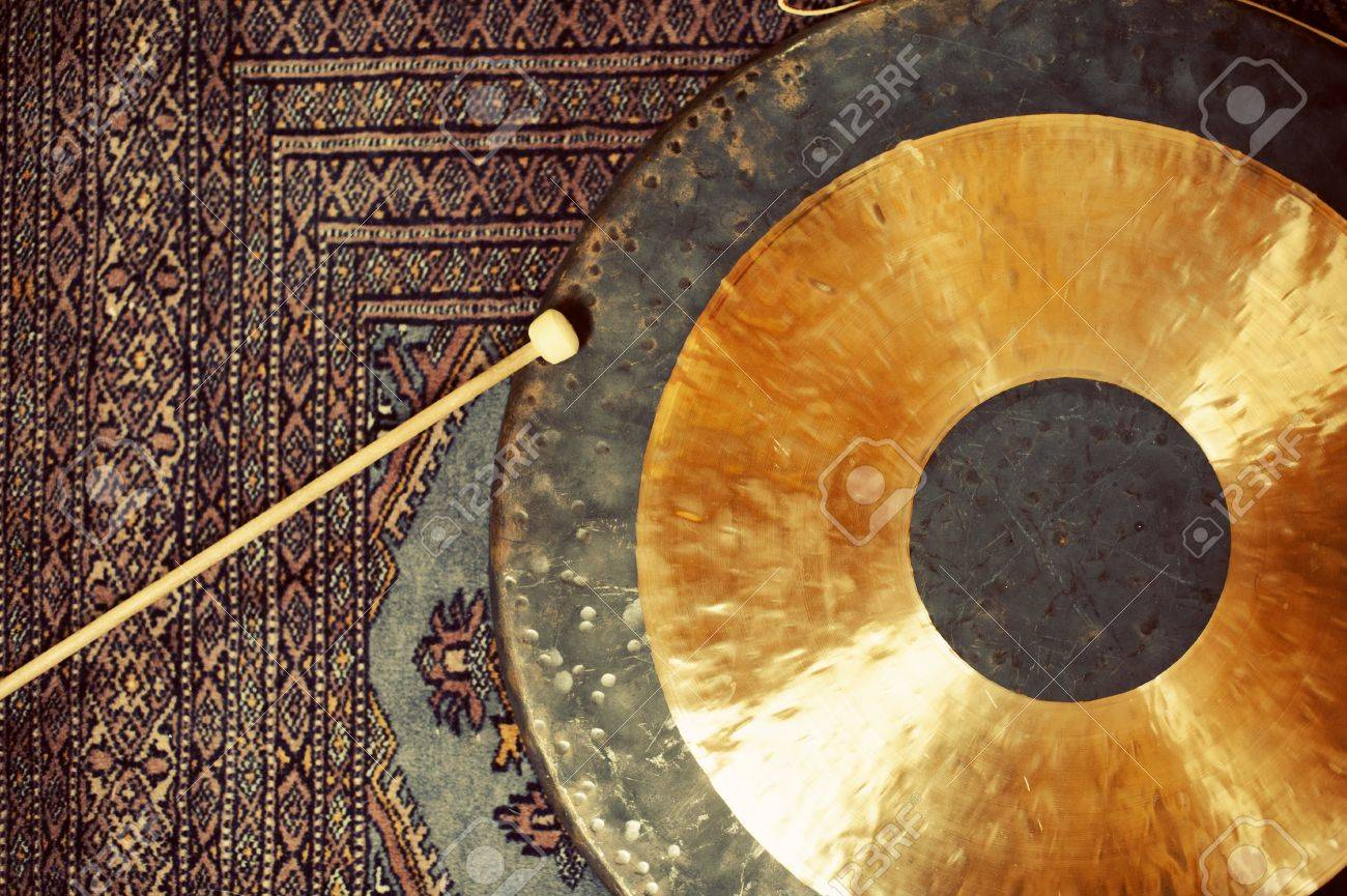 Gong resting on an asian rug - 17135362