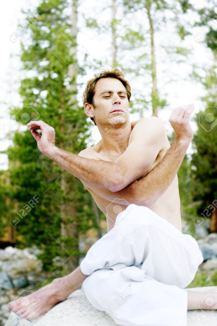 Man in dynamic expression of yoga mudra outdoors in the woods Stock Photo - 17162465
