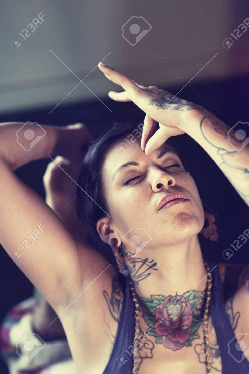 Woman touching her third eye with hand mudra - 17162468
