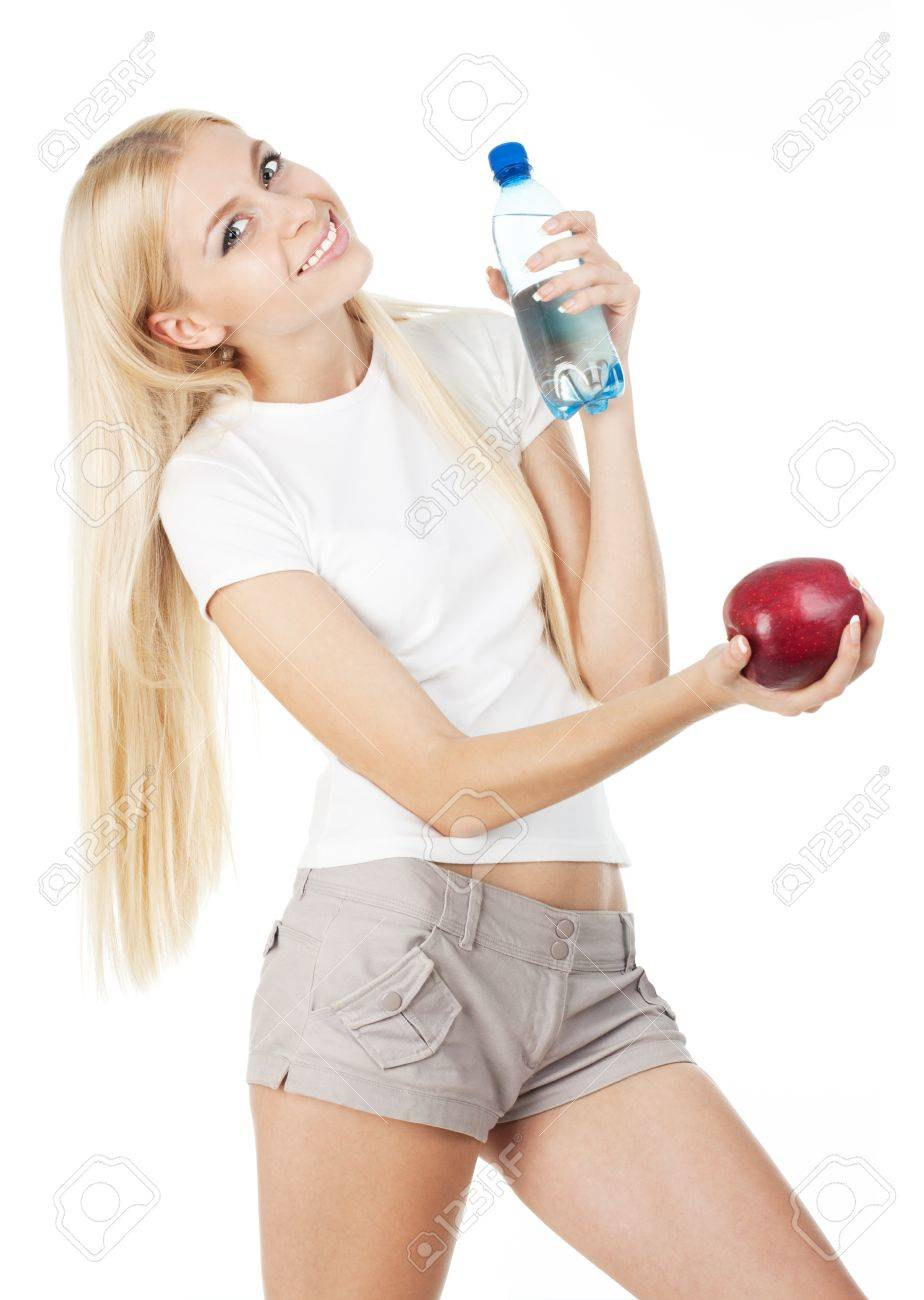 Sportswoman with a bottle of mineral water and red apple, isolated on white background Stock Photo - 10775431