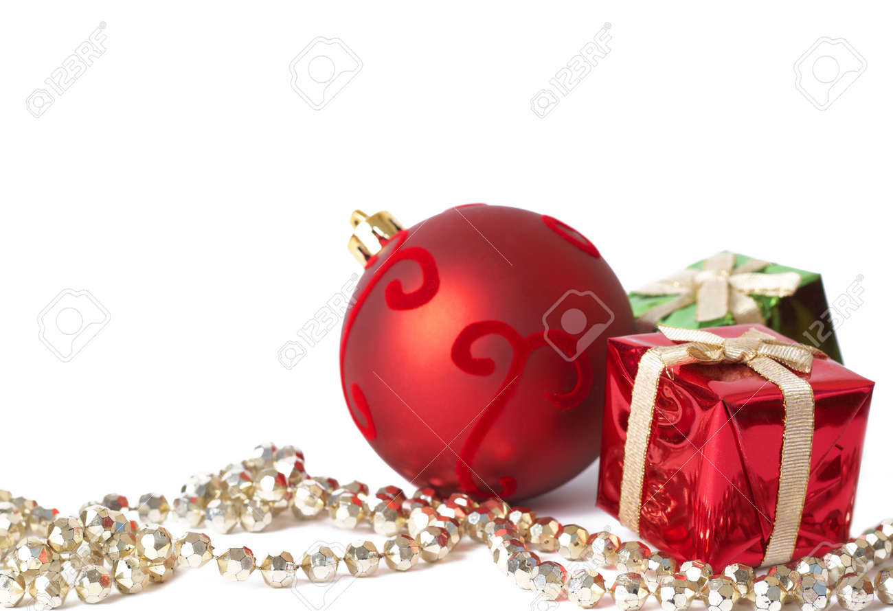Colorful Christmas gift boxes, red ball and golden jewelry isolated on white background with copy space Stock Photo - 4007341