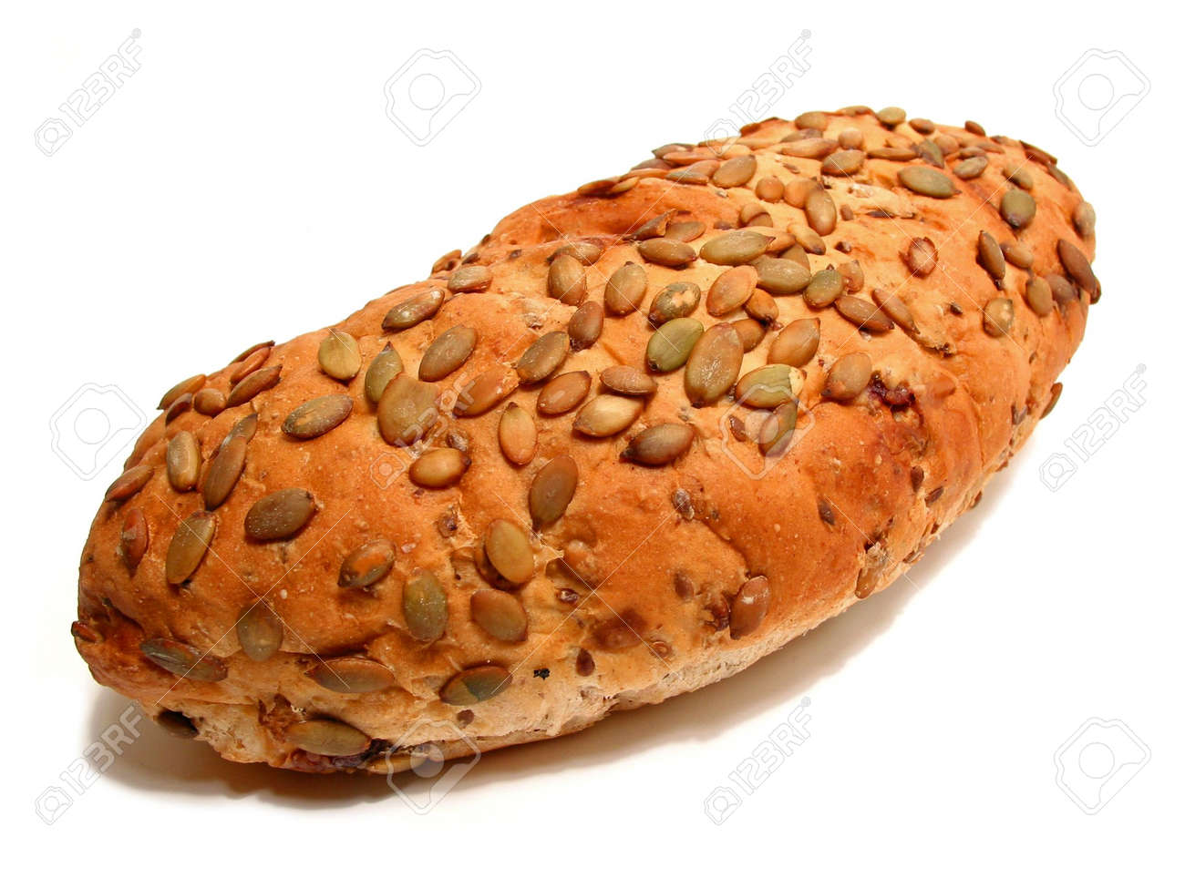Loaf Of Artisan Pumpkin Seed And Cranberry Bread On White Background Stock Photo