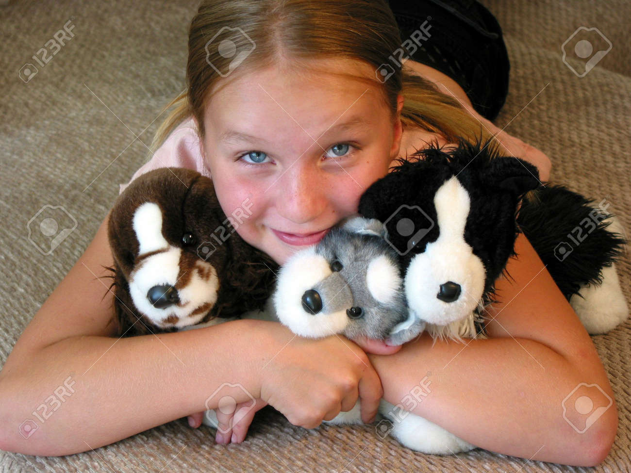 Happy young girl with her favourite plush toys. Stock Photo - 352526