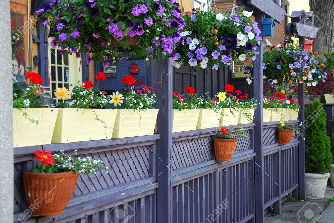 Colorful Fence Of A Restaurant Patio With Flowers Stock Photo   443132