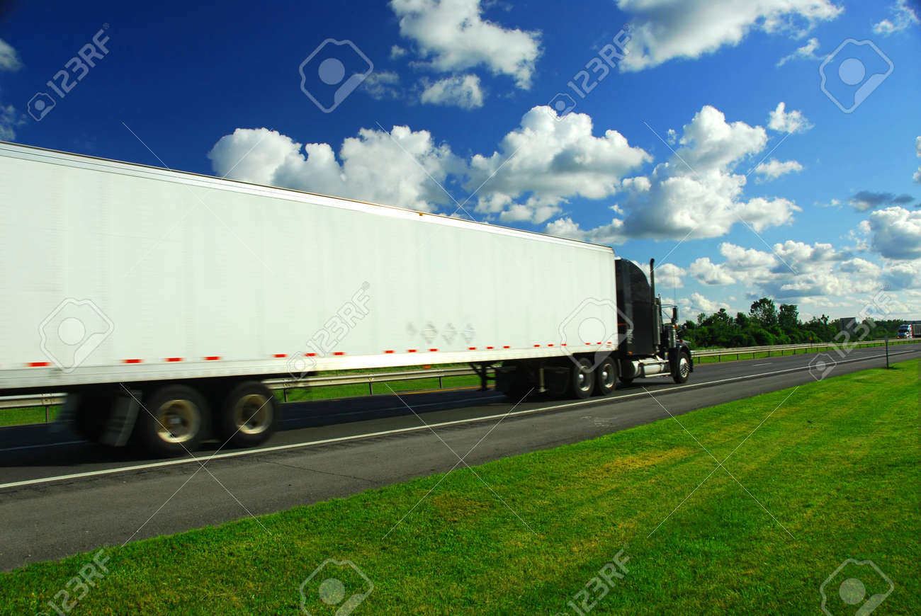 Fast moving truck on highway, blurred because of motion Stock Photo - 475559