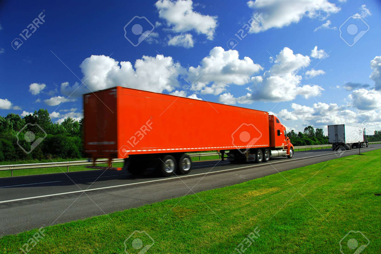 Bright red truck on road, blurred because of fast motion Stock Photo - 475557
