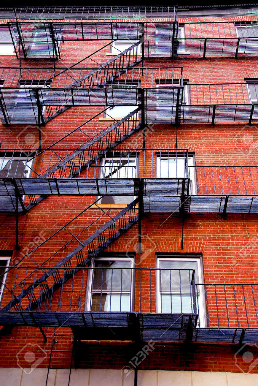 Fragment Of A Red Brick House In Boston Historical North End With Iron Fire  Escapes And