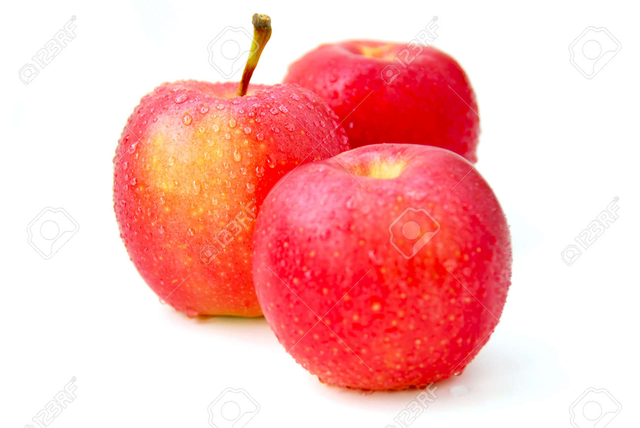 Three red apples with water droplets on white background, focus on the middle apple Stock Photo - 546801
