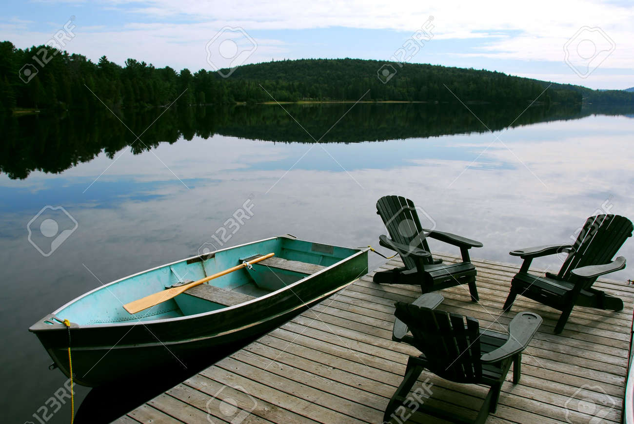 Merveilleux Stock Photo   Three Wooden Adirondack Chairs On A Boat Dock On A Beautiful  Lake In The Evening
