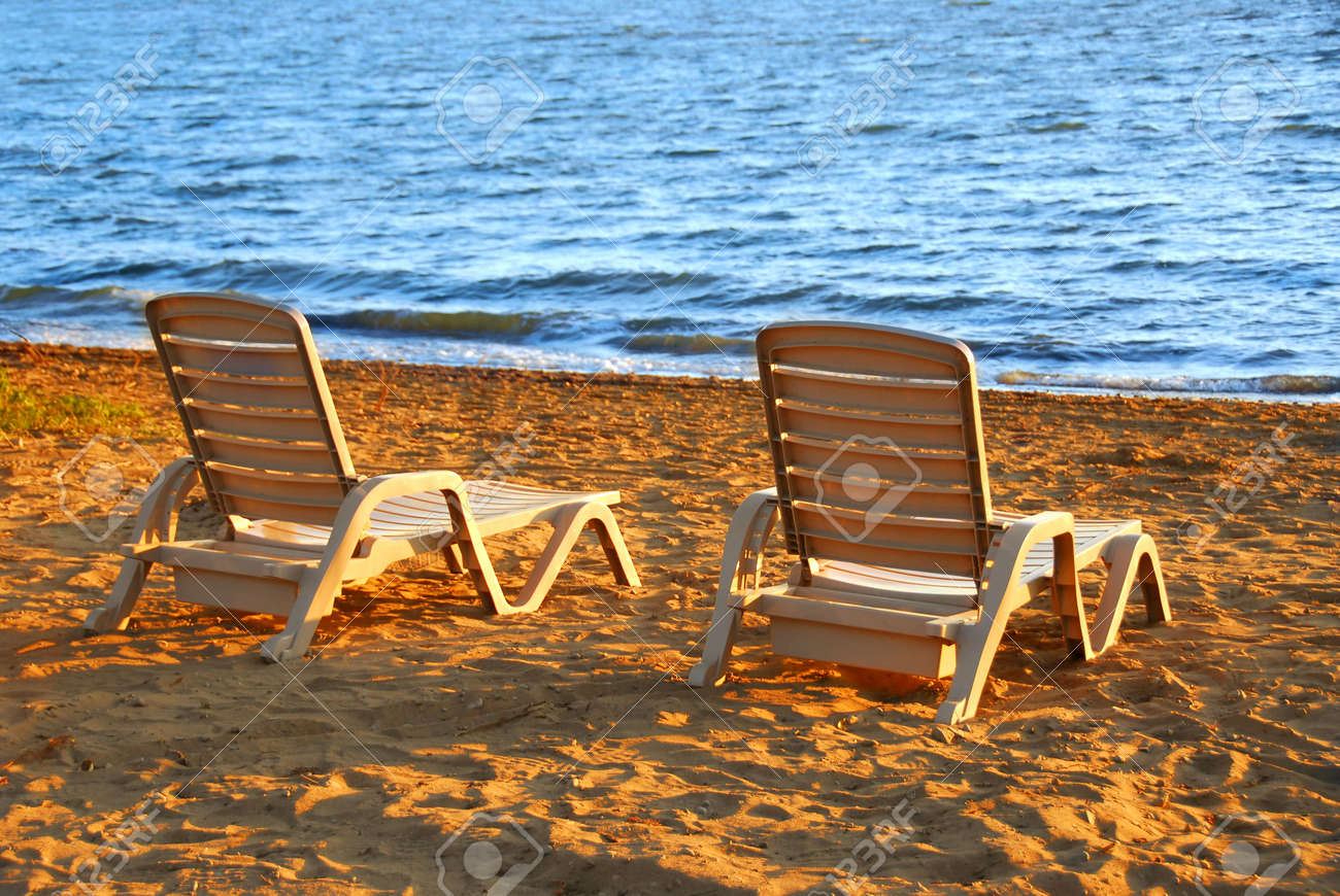 Beach Chairs On Sea Shore In Late Afternoon Stock Photo   687869