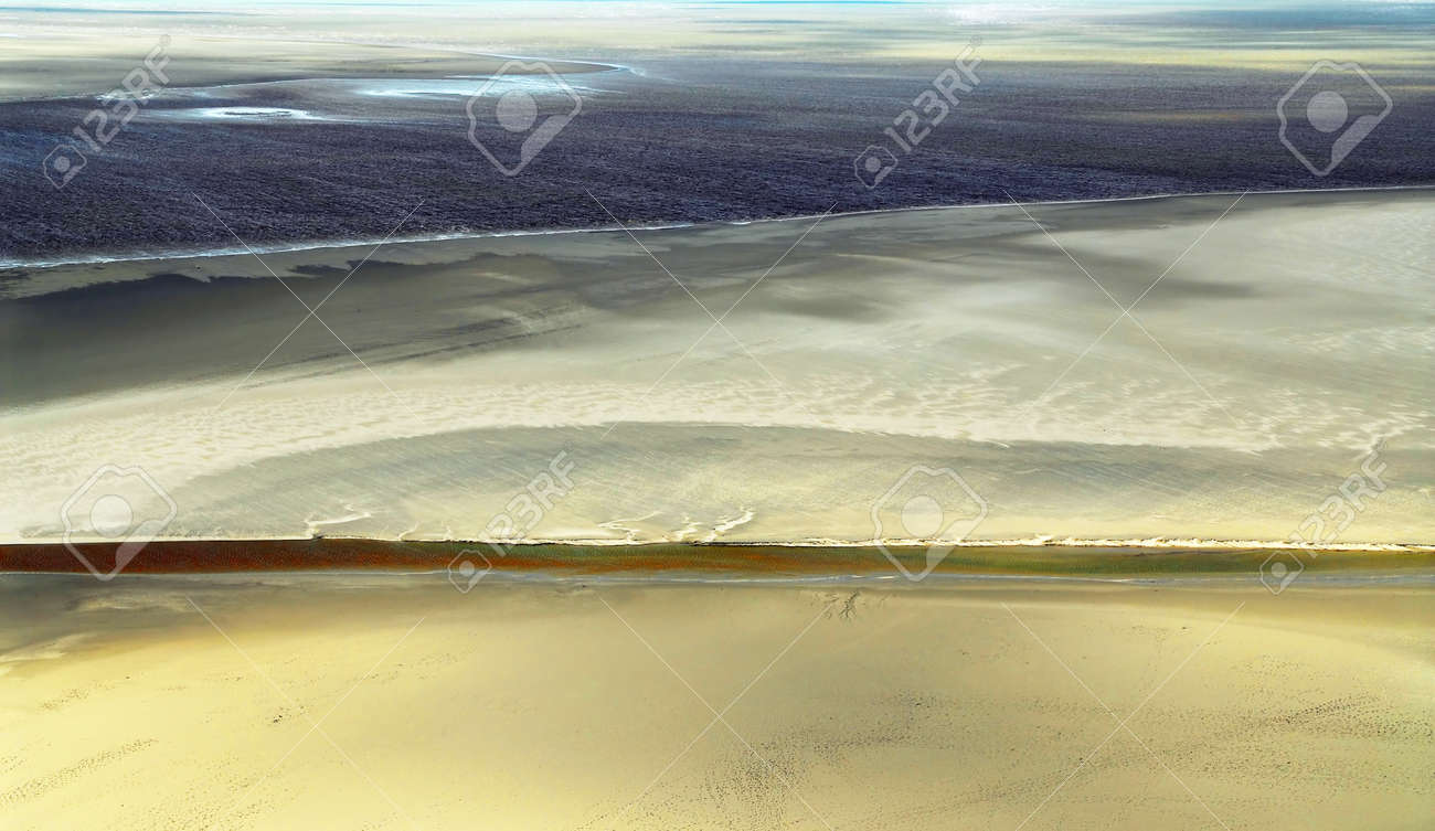 Aerial view of Atlantic ocean at low tide near Mont Saint Michel abbey in France. Background. Stock Photo - 1620936