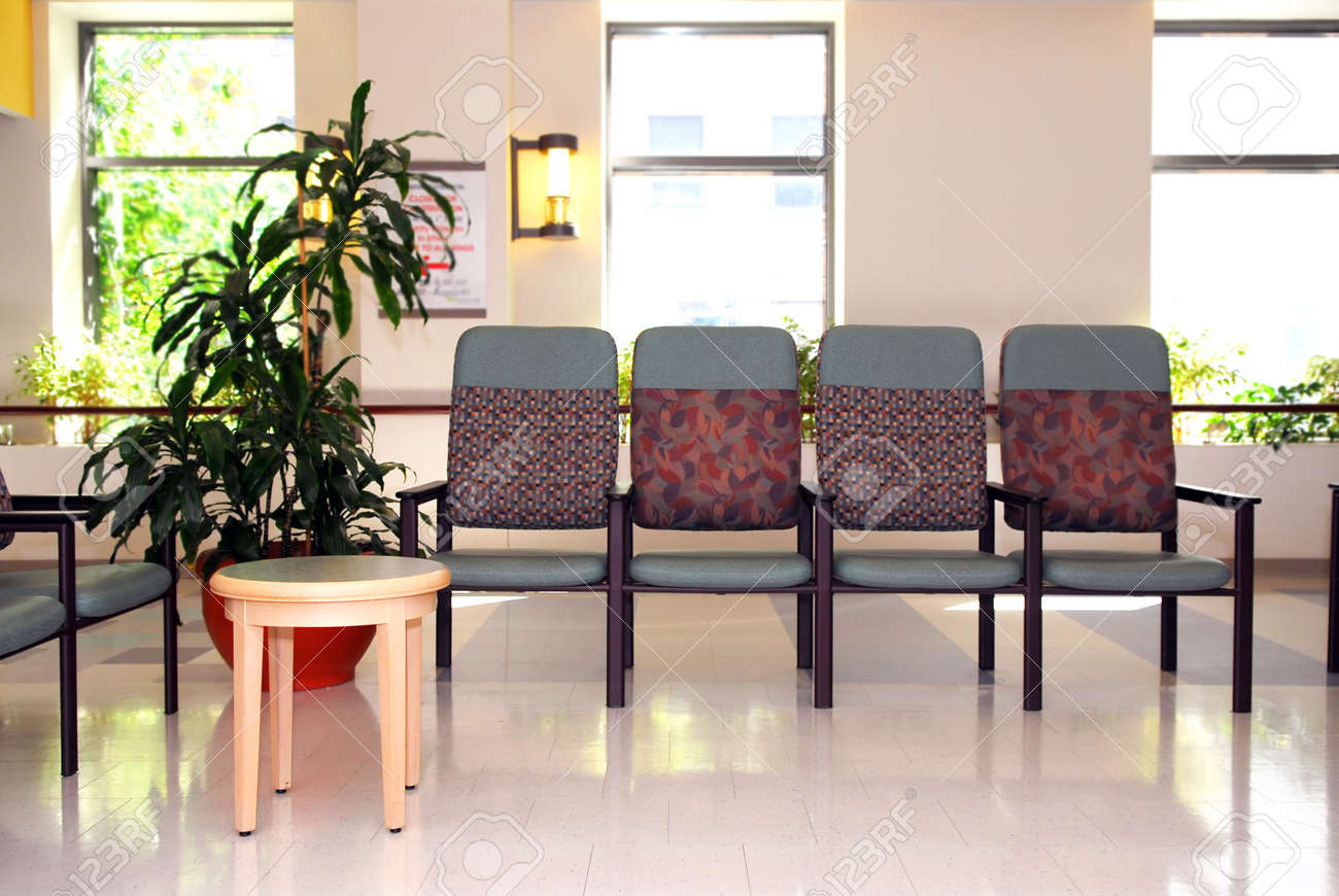 Empty chair in room - Waiting Room In A Hospital Or Clinic With Empty Chairs Stock Photo 1718827