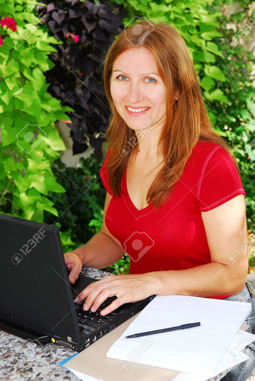 Woman working on her computer at home, small business owner Stock Photo - 1799325