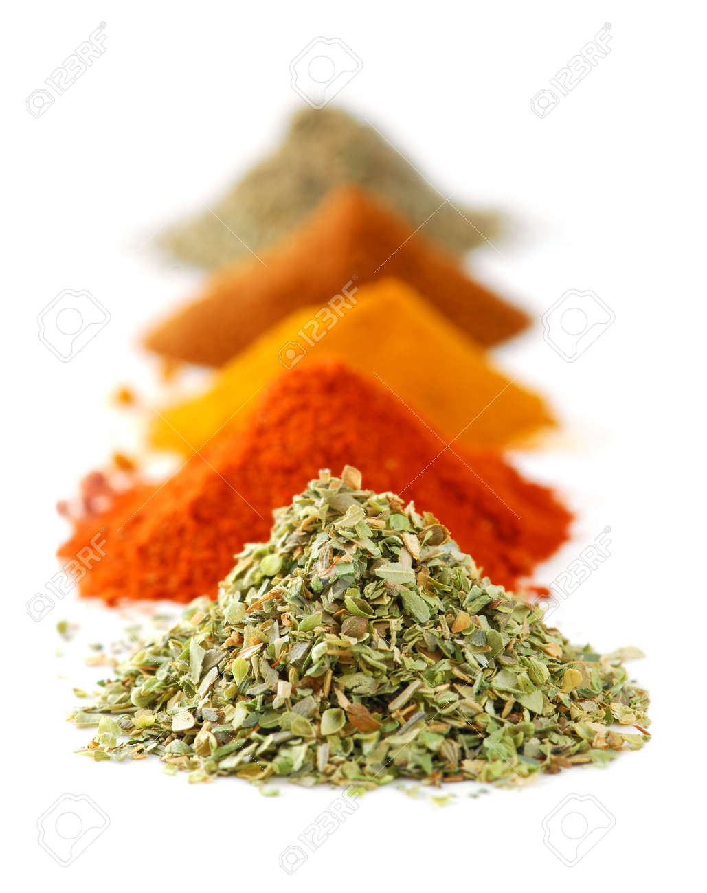 Heaps of various ground spices on white background Stock Photo - 2214171