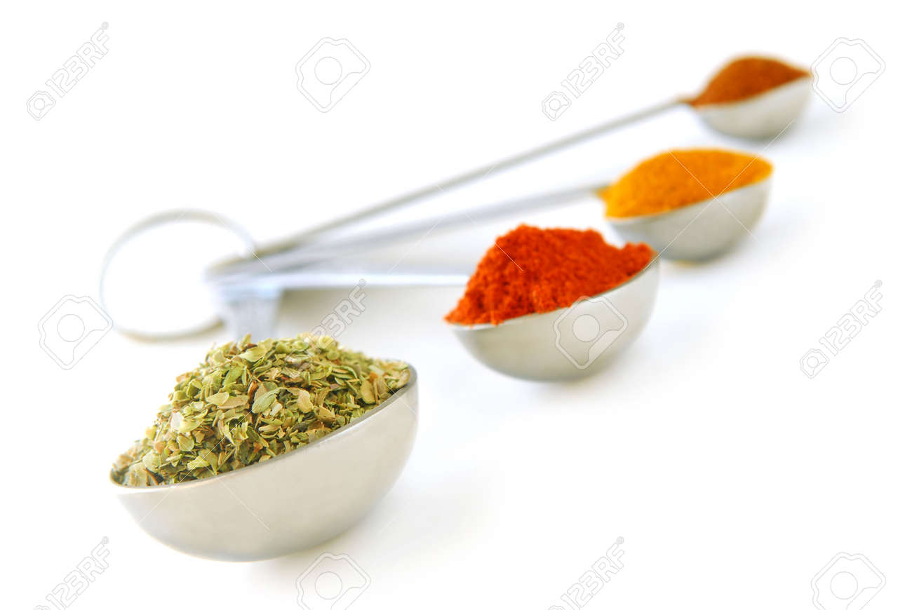 Assorted spices in metal measuring spoons on white background Stock Photo - 2368313