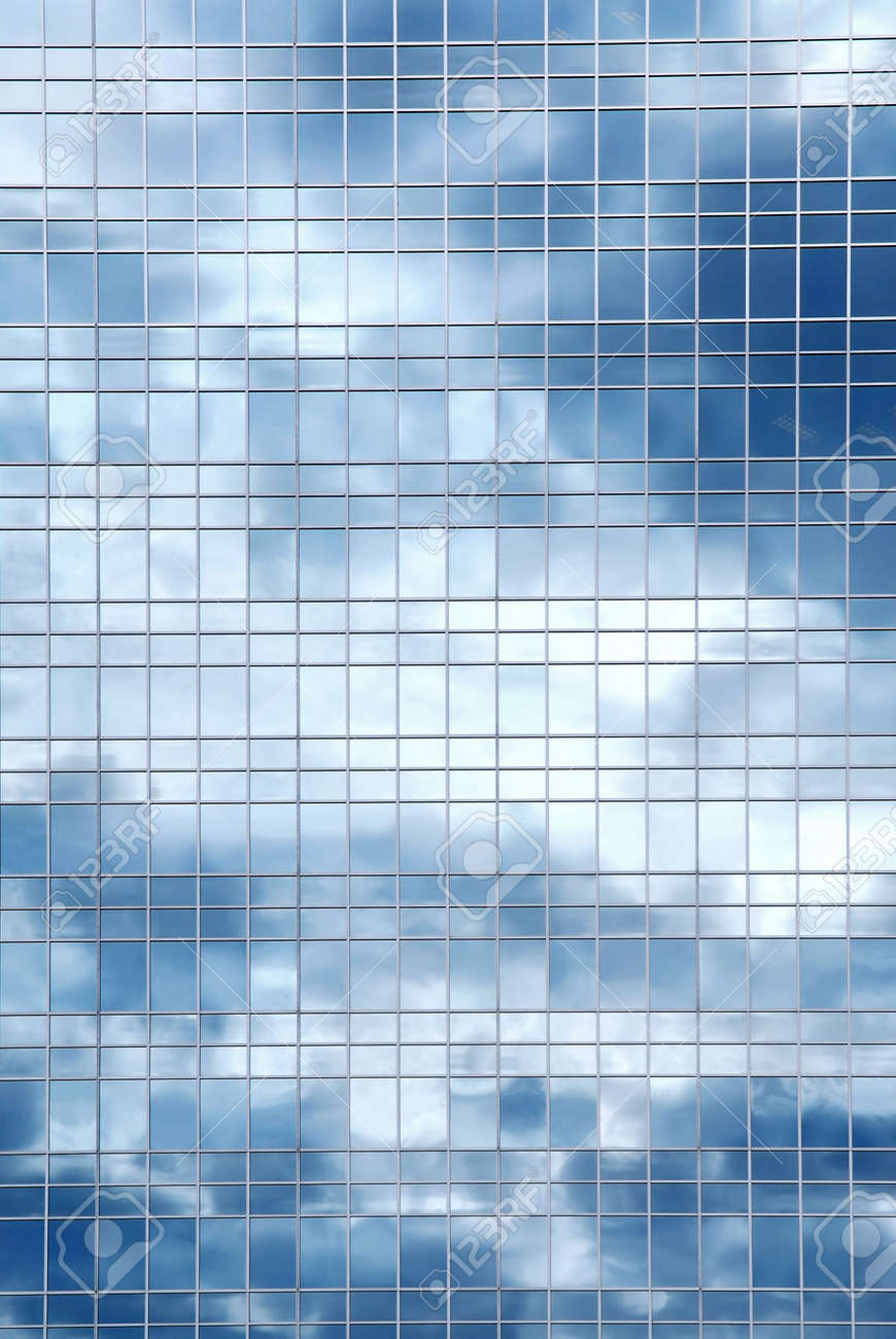 Glass reflection texture  Reflection Of A Cloudy Sky In Glass Wall Of An Office Building ...