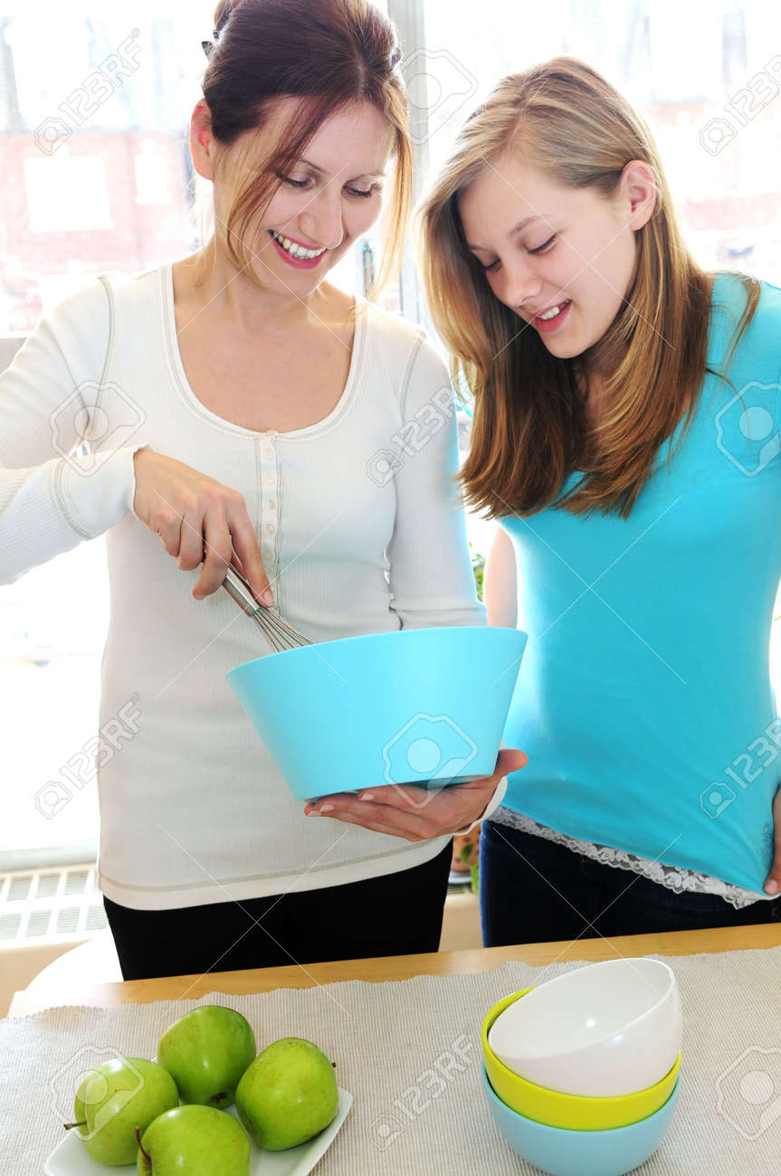 Mother and daughter cooking together at home Stock Photo - 2923942