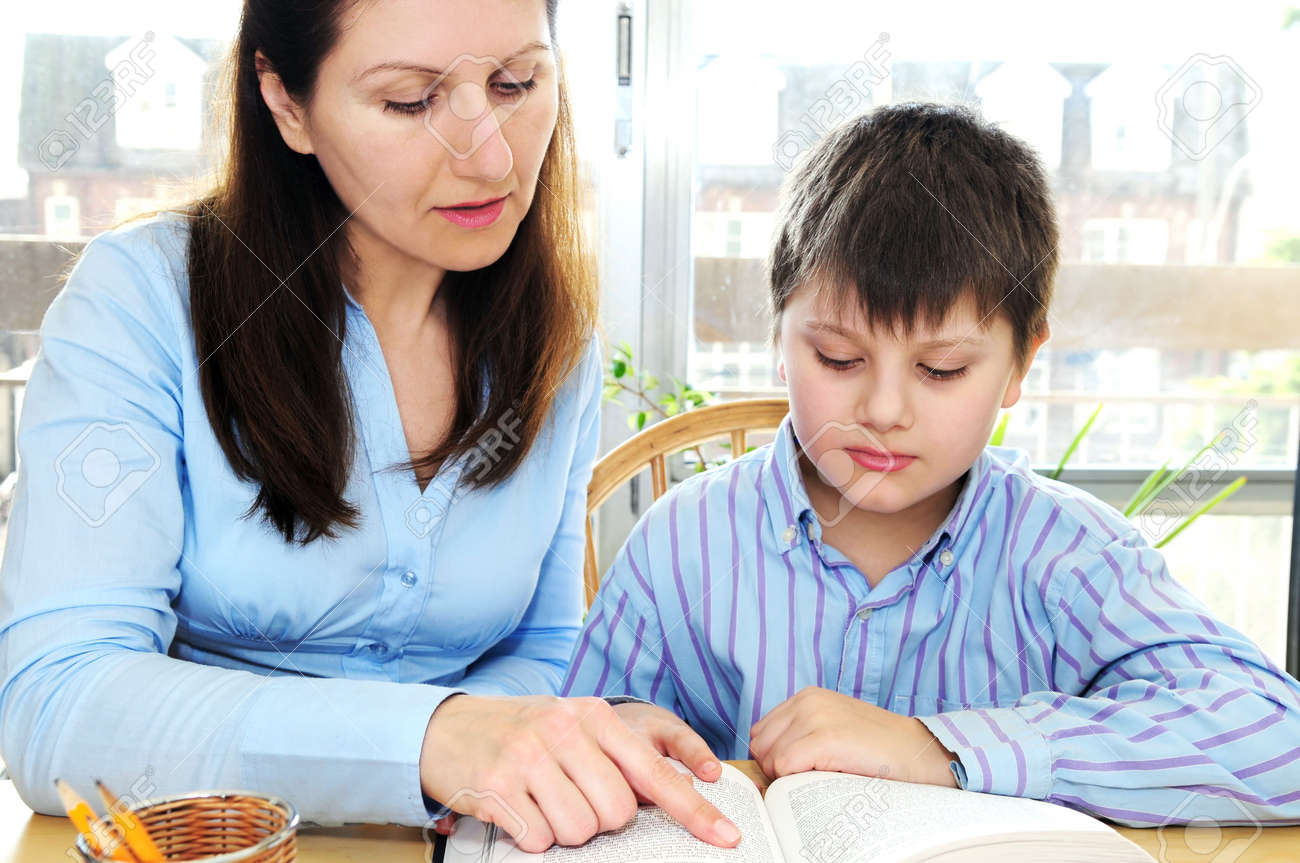 Teacher Or Tutor Helping School Boy To Study Stock Photo, Picture ...