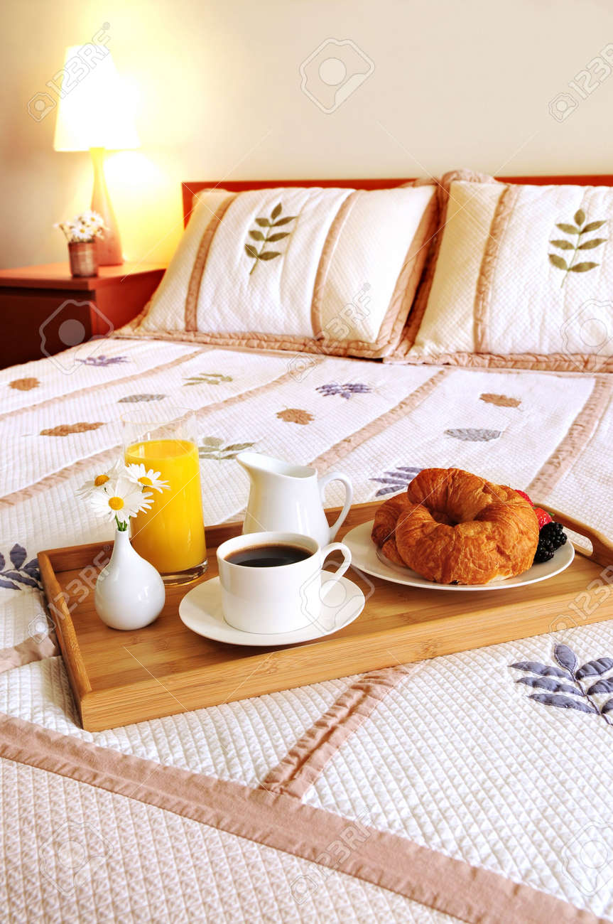 Tray with breakfast on a bed in a hotel room Stock Photo - 3069611
