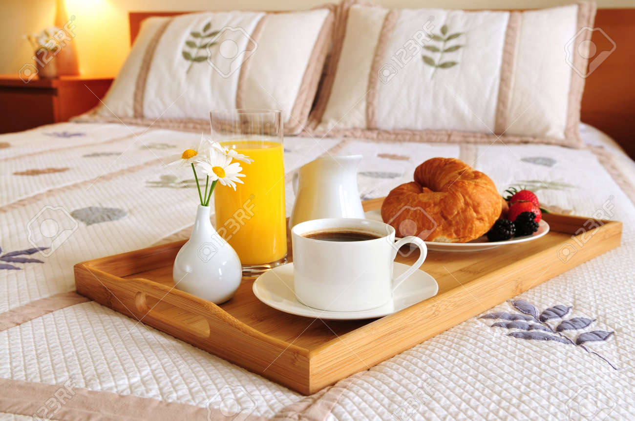 Tray with breakfast on a bed in a hotel room Stock Photo - 3069603