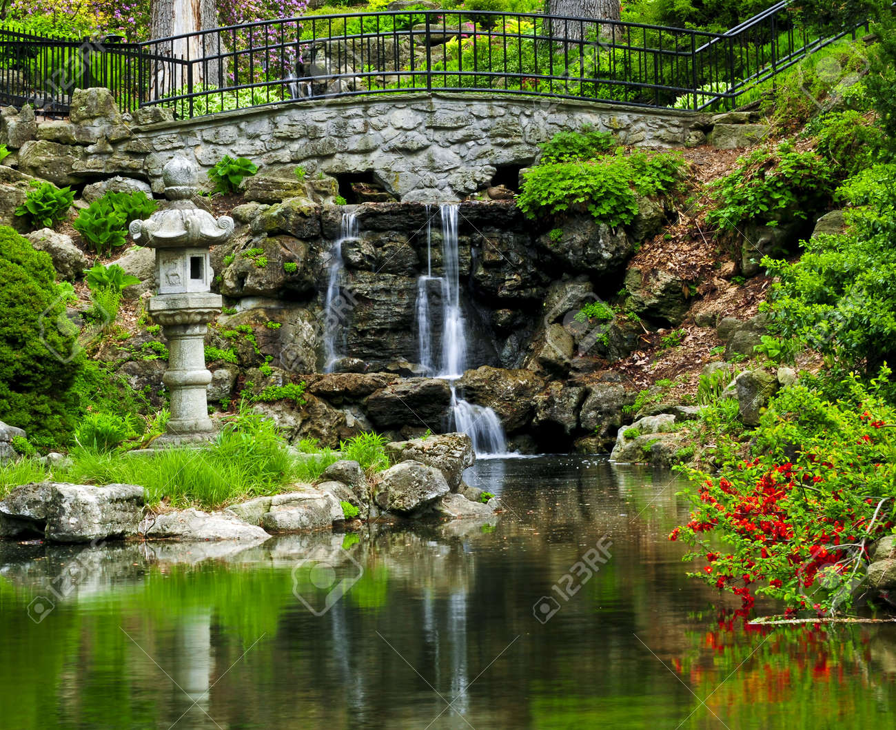 Cascading waterfall and pond in japanese garden Stock Photo - 3143671