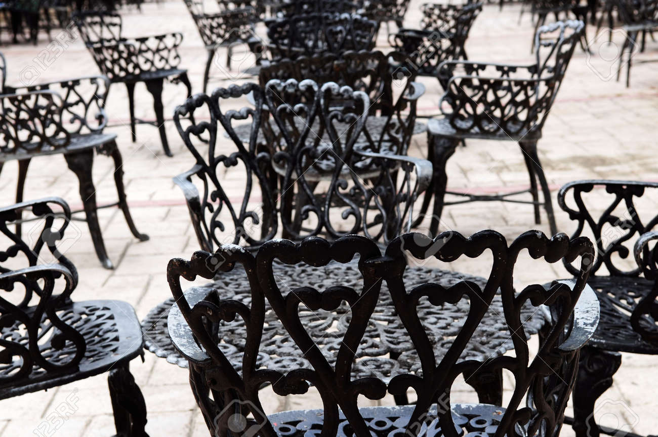 Wrought iron furniture on the outdoor cafe patio Stock Photo - 3227489