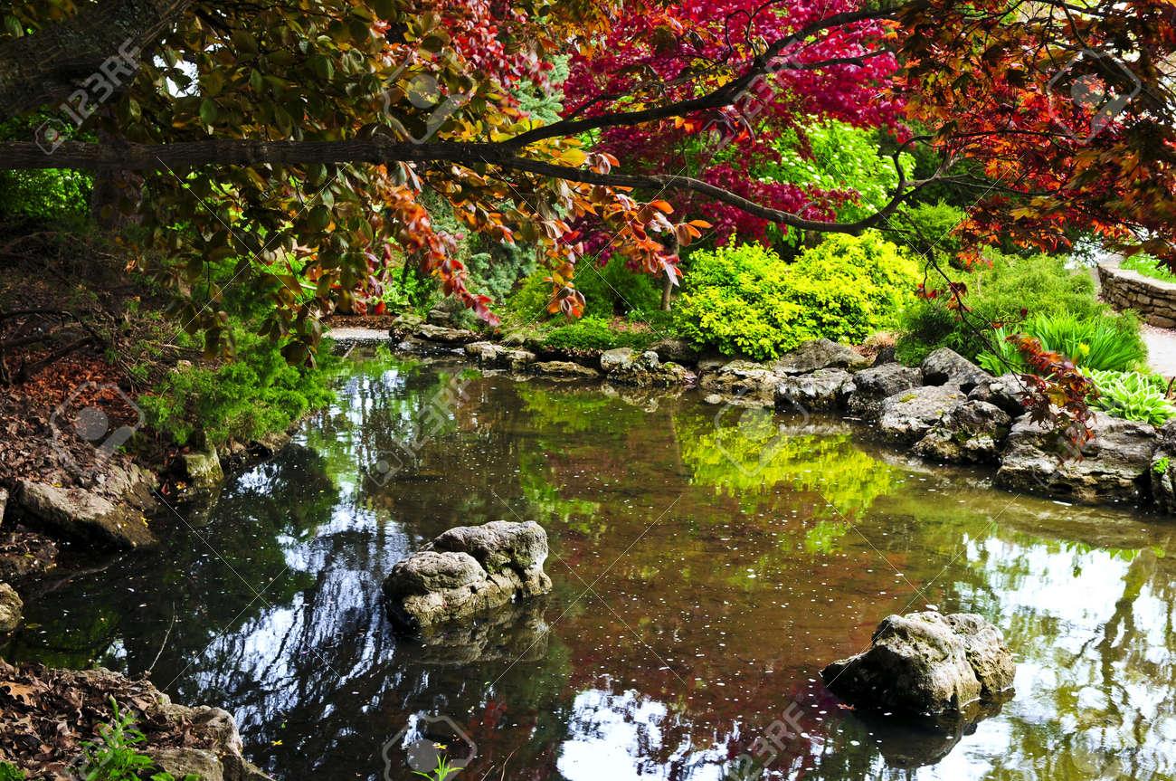 Japanese zen gardens with pond - Pond With Natural Stones In Japanese Zen Garden Stock Photo 3343662