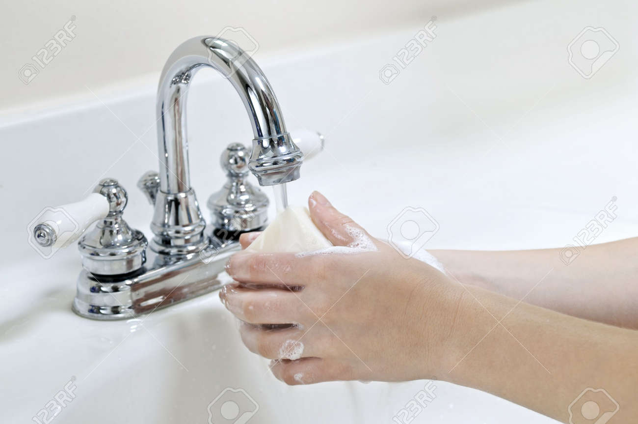 Child washing hands with soap under running water Stock Photo - 3480381