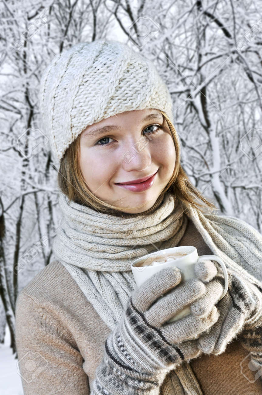 Teenage girl in winter hat with cup of hot chocolate Stock Photo - 3561871