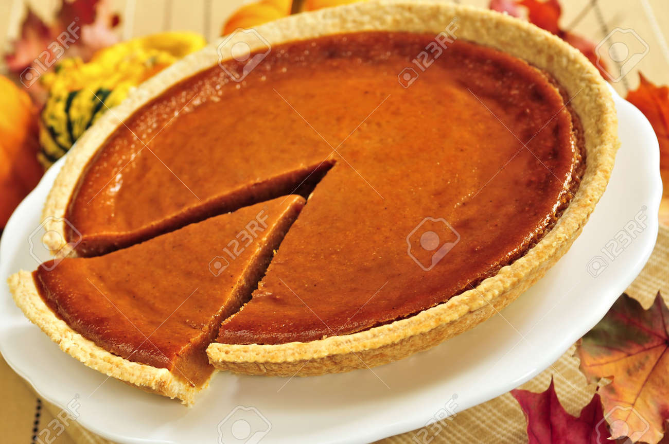 Whole pumpkin pie with a slice cut out Stock Photo - 3743725