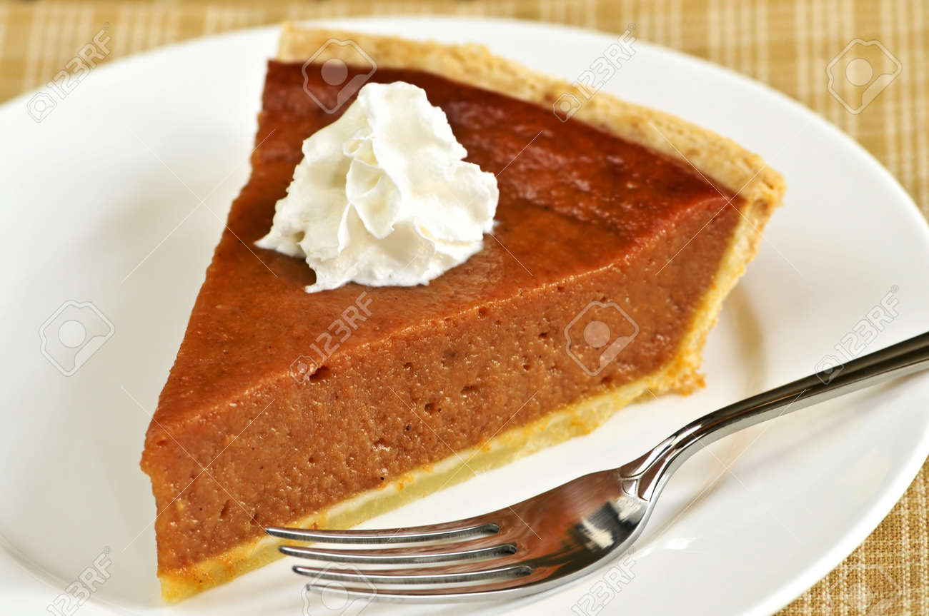 Slice of pumpkin pie with fresh whipped cream Stock Photo - 3743722