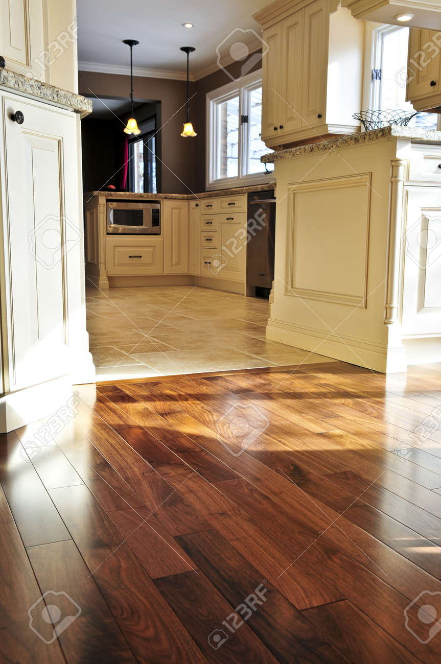 Kitchen And Flooring Hardwood And Tile Floor In Residential Home Kitchen And Dining
