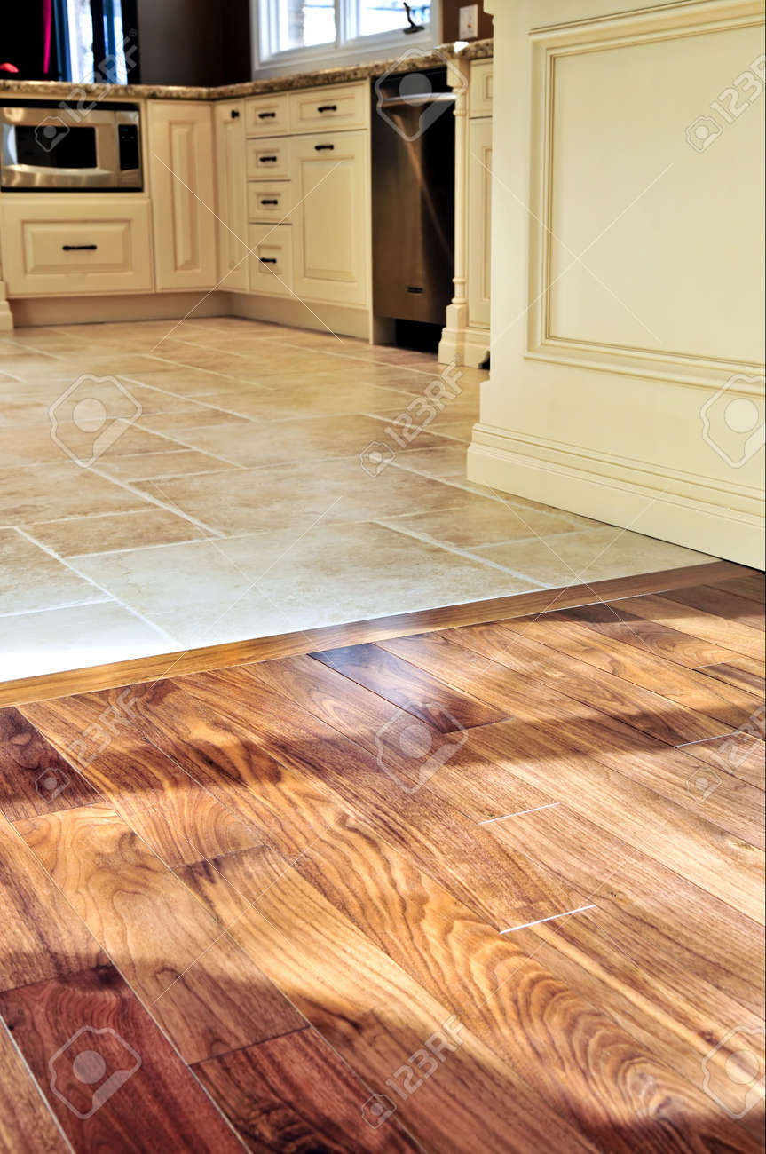 Hardwood And Tile Floor In Residential Home Kitchen And Dining Room Stock  Photo   3930816