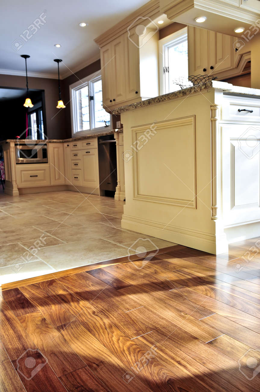 Hardwood And Tile Floor In Residential Home Kitchen Dining Room Stock Photo