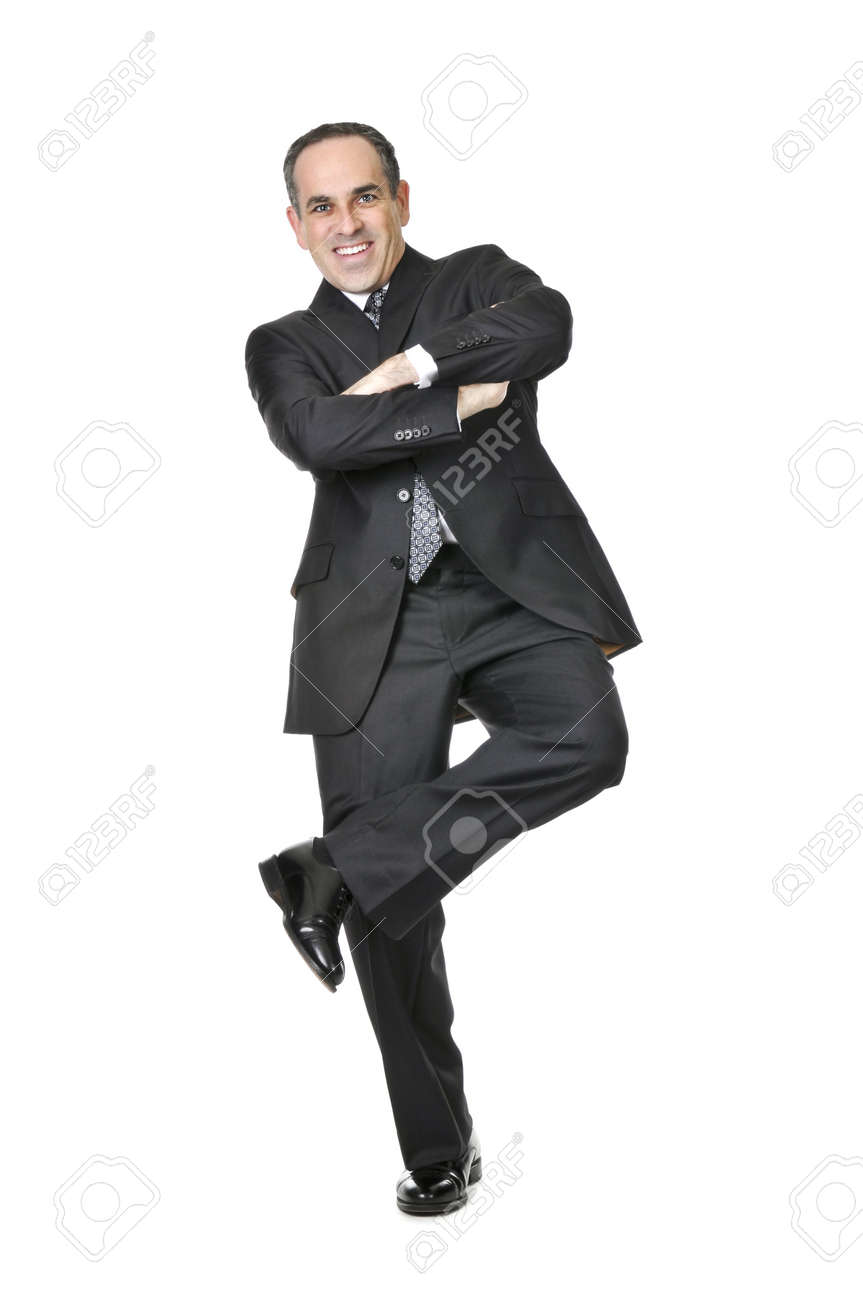 Happy businessman in a suit standing on one leg isolated on white background Stock Photo - 4015574