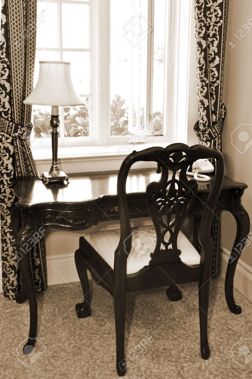Antique chair and desk near the window in living room Stock Photo - 4042321